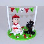 Figurine enfant du pays basque et vachette noire