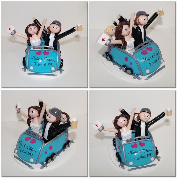 figurines de mariés avec enfant, dans un chariot de fête foraine