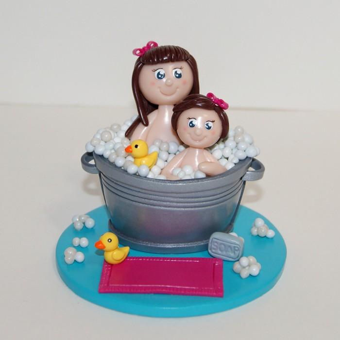 figurines de 2 soeurs dans le bain